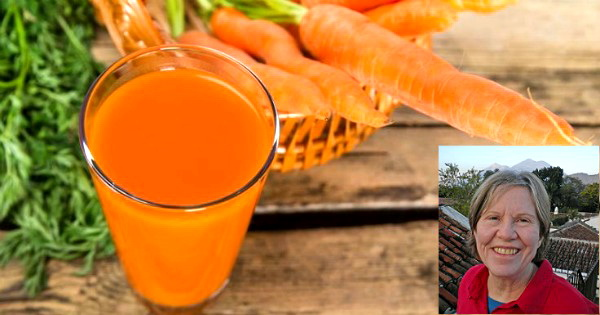 Carrot juice on wooden background